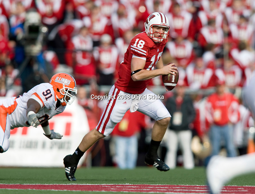 MADISON, WI - OCTOBER 25: Quarterback Dustin Sherer #18 of the Wisconsin Badgers scrambles for yardage against the Illinois Fighting Illini at Camp Randall Stadium on October 25, 2008 in Madison, Wisconsin. The Badgers beat the Fighting Illini 27-17. (Photo by David Stluka)