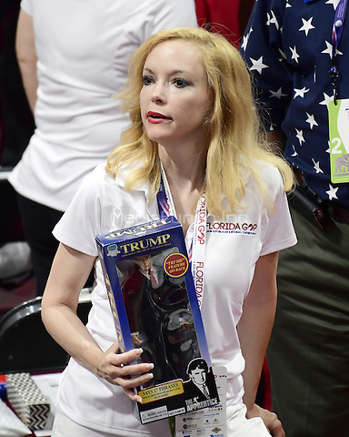 Florida delegate Dana Dougherty holds a Donald Trump doll on the floor of the 2016 Republican National Convention held at the Quicken Loans Arena in Cleveland, Ohio on Tuesday, July 19, 2016.<br /> Credit: Ron Sachs / CNP/MediaPunch<br /> (RESTRICTION: NO New York or New Jersey Newspapers or newspapers within a 75 mile radius of New York City)