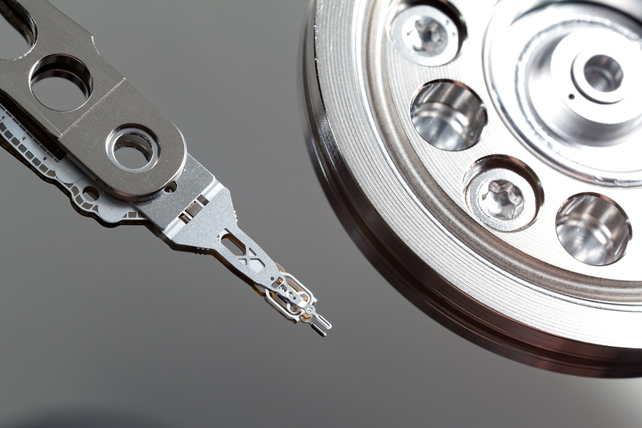 Close-up of read-and-write head and disk platter in hard disk drive