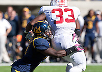 October 20th, 2012: California's Avery Sebastian tackles Stanford's Stepfan Taylor during a game at Memorial Stadium at Berkeley, Ca   Stanford defeated California 21 - 3