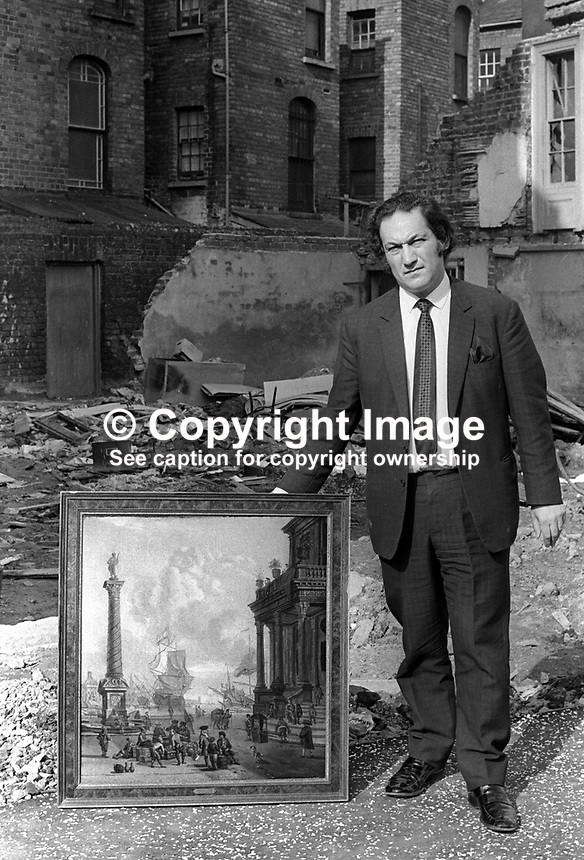 Leonard Kaitcer with a painting he salvaged from Provisional IRA bomb attack on his Belfast N Ireland antiques shop on 26th January 1972. Mr Kaitcer was kidnapped over two years later. His body was found on the Glen Road, Andersonstown. Although no organisation admitted responsibility it was assumed that a republican organisation was involved because of where the body was found. 197201260034b<br /> <br /> Copyright Image from Victor Patterson, 54 Dorchester Park, Belfast, UK, BT9 6RJ<br /> <br /> t1: +44 28 9066 1296 (from Rep of Ireland 048 9066 1296)<br /> t2: +44 28 9002 2446 (from Rep of Ireland 048 9002 2446)<br /> m: +44 7802 353836<br /> <br /> e1: victorpatterson@me.com<br /> e2: victorpatterson@gmail.com<br /> <br /> www.victorpatterson.com<br /> <br /> IMPORTANT: Please see my Terms and Conditions of Use at www.victorpatterson.com