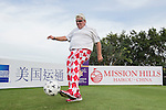 John Daly kicks a football at the 14th hole of the World Celebrity Pro-Am 2016 Mission Hills China Golf Tournament on 21 October 2016, in Haikou, China. Photo by Victor Fraile / Power Sport Images