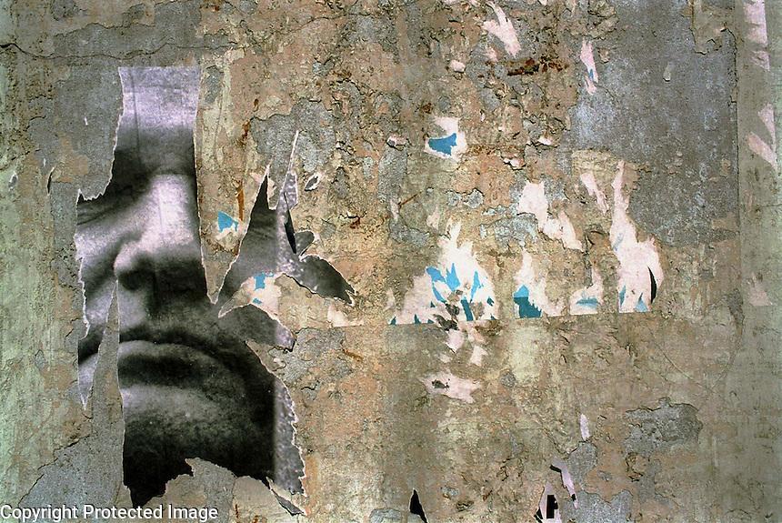 SERBIA. Belgrade. 01 April 2001..A torn Milosevic poster on a wall in Belgrade city centre..