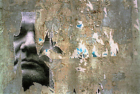 SERBIA. Belgrade. 01 April 2001..A torn Milosevic poster on a wall in Belgrade city centre..