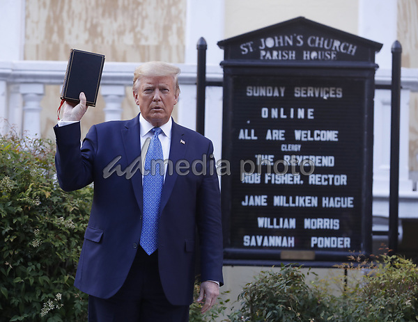 =trumpo= poses with a bible outside St. John's Episcopal Church after delivering remarks in the Rose Garden at the White House in Washington, DC, USA, 01 June 2020. Trump addressed the nationwide protests following the death of George Floyd in police custody.<br /> Credit: Shawn Thew / Pool via CNP/AdMedia