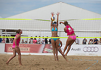 England block a Dutch attempt during the Women's England v Holland Volleyball match at Sandbanks, Poole, England on 10 July 2015. Photo by Andy Rowland.