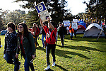 Students march at the Occupy UC Davis encampment for a general assembly on the Quad, November 28, 2011.