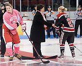 Jenn Wakefield (BU - 9), Kathy Wynters, Dani Rylan (Northeastern - 2) - The Boston University Terriers defeated the visiting Northeastern University Huskies 3-2 on Saturday, January 28, 2012, at Agganis Arena in Boston, Massachusetts.