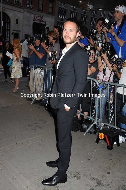 "actor Taylor Kitsch arrives for the special New York screening of ""Savages"" on June 27, 2012 at The SVA Theatre in New York City. .The movie stars John Travolta, Blake Lively, and Taylor Kitsch and is directed by Oliver Stone."
