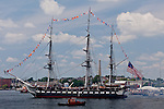 The USS Constitution passes the Bunker Hill Monument on her  July 4th Turnaround Cruise in Boston Harbor, Boston, MA, USA