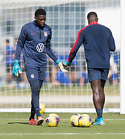 Sean Johnson, Bill Hamid of the United States warms up during a drill