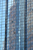Building reflection  on skyscraper windows, vertical image