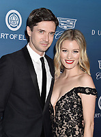 LOS ANGELES, CA - JANUARY 05: Topher Grace (L) and Ashley Grace attend Michael Muller's HEAVEN, presented by The Art of Elysium at a private venue on January 5, 2019 in Los Angeles, California.<br /> CAP/ROT/TM<br /> ©TM/ROT/Capital Pictures