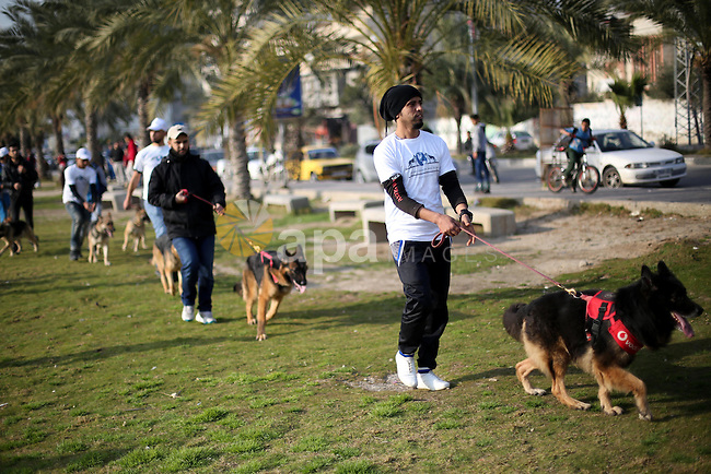 Palestinians show their dogs during the first dog show organized by local dog breeders, in Gaza City February 5, 2016. Following announcements over social media for dog owners to take part, more than thirty different breeds were brought to the show aimed at encouraging the breeding of dogs. Photo by Mohammed Asad