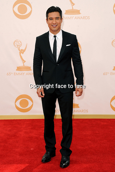 Mario Lopez arrives at the 65th Primetime Emmy Awards at Nokia Theatre on Sunday Sept. 22, 2013, in Los Angeles.<br />