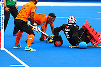 Najmi Jazlan makes a goaline block for Malaysia during the Hockey World League Quarter-Final match between India and Malaysia at the Olympic Park, London, England on 22 June 2017. Photo by Steve McCarthy.