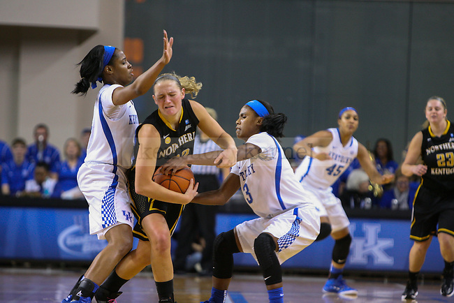 UK guard Kyvin Goodin-Rogers (right) and and point guard Janee Thompson (left) apply pressure to NKU guard Kelley Wiegman (22) in the first half at the University of Kentucky versus Northern Kentucky University women's basketball game at Memorial Coliseum in Lexington, Ky., on Wednesday, December 3, 2014. Photo by Cameron Sadler | Staff