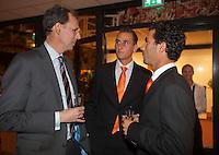 08-02-12, Netherlands,Tennis, Den Bosch, Daviscup Netherlands-Finland, Official Dinner, KNLTB Directeur Evert Jan Hulshof in gesprek met Thiemo de Bakker en Jean-Julien Rojer(R)