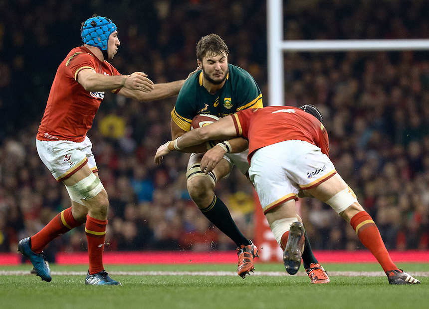 South Africa's Lodewyk De Jager is tackled by Wales' Luke Charteris<br /> <br /> Photographer Simon King/CameraSport<br /> <br /> International Rugby Union Friendly - Wales v South Africa - Saturday 26th November 2016 - Principality Stadium - Cardiff<br /> <br /> World Copyright &copy; 2016 CameraSport. All rights reserved. 43 Linden Ave. Countesthorpe. Leicester. England. LE8 5PG - Tel: +44 (0) 116 277 4147 - admin@camerasport.com - www.camerasport.com