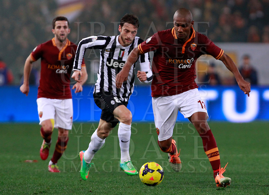 Calcio, quarti di finale di Coppa Italia: Roma vs Juventus. Roma, stadio Olimpico, 21 gennaio 2014.<br /> AS Roma defender Maicon, of Brazil, is challenged by Juventus midfielder Claudio Marchisio, center, during the Italian Cup round of eight final football match between AS Roma and Juventus, at Rome's Olympic stadium, 21 January 2014. At left, AS Roma midfielder Miralem Pjanic, of Bosnia.<br /> UPDATE IMAGES PRESS/Isabella Bonotto