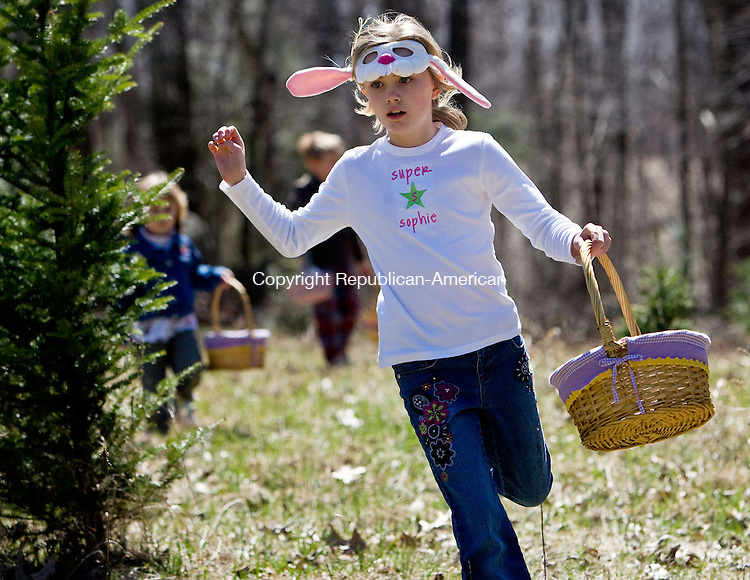 WOODBURY, CT - 05 APRIL 2009 -040509JT02-<br /> Sophie Rundhaug, 9, of Danbury, runs through the Christmas tree farm at Flanders Nature Center in search of more Easter eggs during Sunday's Easter egg hunt in Woodbury.<br /> Josalee Thrift Republican-American