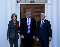 United States President-elect Donald Trump (C) and Vice President-elect Mike Pence (R) pose with Betsy DeVos at the clubhouse of Trump International Golf Club, November 19, 2016 in Bedminster Township, New Jersey. <br /> Credit: Aude Guerrucci / Pool via CNP /MediaPunch