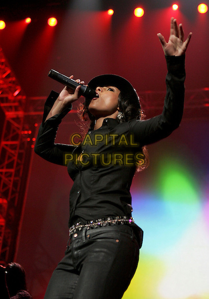 ALICIA KEYS.Performs live at 102.7Õs KIIS-FMÕs 4th Annual Jingle Ball held at The Pond of Anaheim in Anaheim, California, USA, December 4th 2004..half length gig on stage concert black shirt trousers hat.Ref: DVS.www.capitalpictures.com.sales@capitalpictures.com.©Capital Pictures.