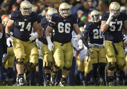 November 03, 2012:  The Notre Dame offense takes the field during NCAA Football game action between the Notre Dame Fighting Irish and the Pittsburgh Panthers at Notre Dame Stadium in South Bend, Indiana.  Notre Dame defeated Pittsburgh 29-26 in three overtimes.