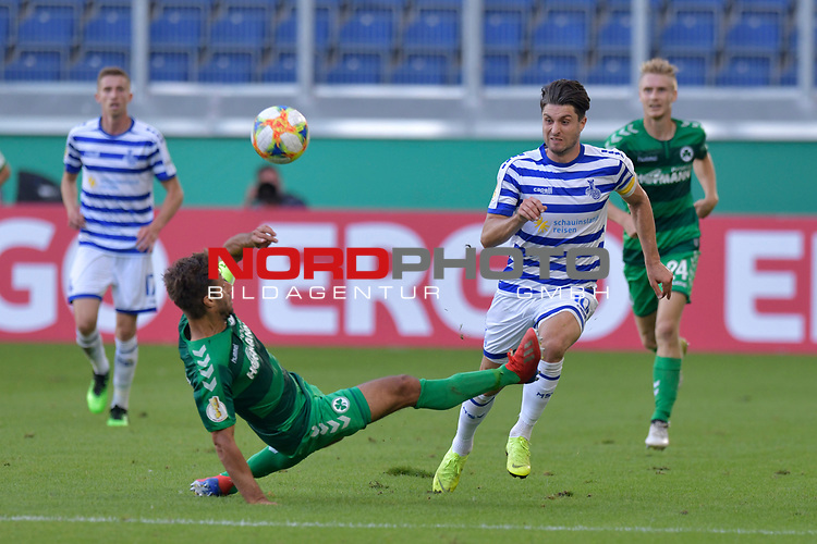 11.08.2019 , Schauinsland-Reisen Arena, Duisburg, DFB Pokal<br /> <br /> DFB REGULATIONS PROHIBIT ANY USE OF PHOTOGRAPHS AS IMAGE SEQUENCES AND/OR QUASI-VIDEO.<br /> <br /> im Bild / picture shows Marco Caligiuri ( Greuther Fuerth #13 ) gegen Moritz Stoppelkamp ( MSV Duisburg #10 ).<br /> <br /> <br /> Foto © nordphoto / Freund