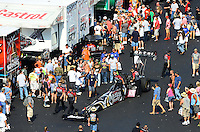Sept. 15, 2012; Concord, NC, USA: NHRA crew members for top fuel dragster driver Shawn Langdon surrounded by fans during qualifying for the O'Reilly Auto Parts Nationals at zMax Dragway. Mandatory Credit: Mark J. Rebilas-