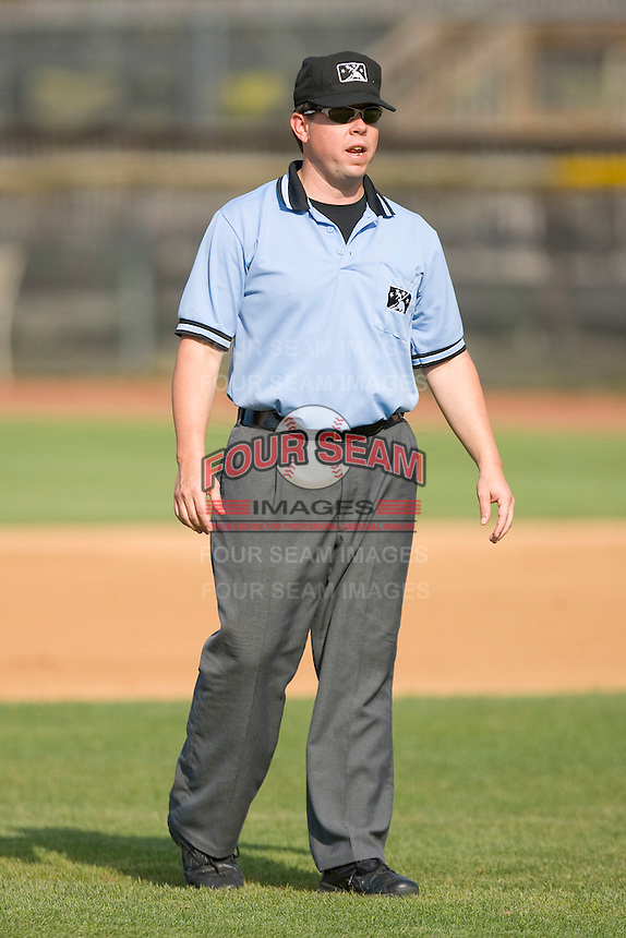 Umpire Shea Gipson handles the calls on the base paths during a South Atlantic League game between the Rome Braves and the Hickory Crawdads at  L.P. Frans Stadium May 23, 2010, in Hickory, North Carolina.  The Rome Braves defeated the Hickory Crawdads 5-1.  Photo by Brian Westerholt / Four Seam Images