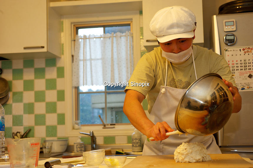 Japanese baker, Mizuki Taira, 36, in his home bakery called Gateau d'Ange, Kamakura, Japan 09 Feb 11. The the waiting list  for his bread is now eight years long.  Mizuki Taira, turned to baking after a nasty bicycle accident, as part of his rehabilitation.