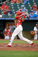 "Palm Beach Cardinals third baseman Leobaldo Pina (3) follows through on a swing during a game against the Charlotte Stone Crabs on July 22, 2017 at Roger Dean Stadium in Palm Beach, Florida.  The Cardinals wore special ""Ugly Sweater"" jerseys for Christmas in July.  Charlotte defeated Palm Beach 5-2.  (Mike Janes/Four Seam Images)"