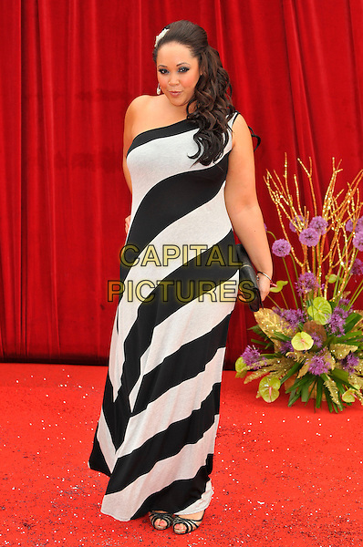 DONNALEIGH BAILEY .Attending the British Soap Awards 2011, .Granada Television Studios, Quay Street, Manchester, England, UK, .March 14th 2011..arrivals full length black and white striped dress one shoulder maxi .CAP/CAS.©Bob Cass/Capital Pictures.