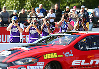 Jun 10, 2016; Englishtown, NJ, USA; Photographers takes photos of NHRA pro stock driver Erica Enders-Stevens during qualifying for the Summernationals at Old Bridge Township Raceway Park. Mandatory Credit: Mark J. Rebilas-USA TODAY Sports