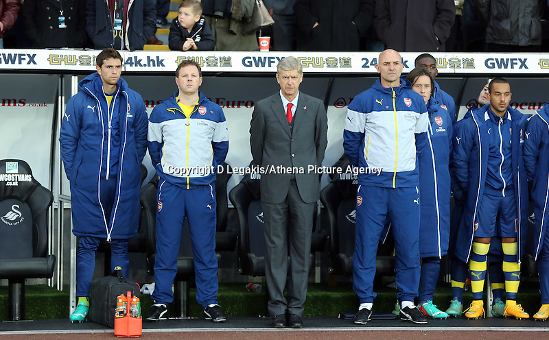 Sunday 09 November 2014 <br /> Arsenal bench with manager Arsene Wenger (C) observe a minute's silence for Remembrance Sunday<br /> Barclays Premier League, Swansea City FC v Arsenal City at the Liberty Stadium, Swansea, Great Britain. EPA/Dimitris Legakis