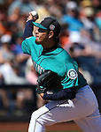 Seattle Mariners' Hisashi Iwakuma pitches in a spring training game against the SF Giants in Peoria, Ariz., on Wednesday, March 16, 2016. <br /> Photo by Cathleen Allison