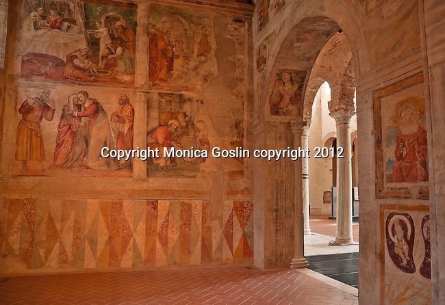 Side Chapel of the Church of San Salvatore which is a culimination of different centuries from the Roman ruins to 6th century columns to 15th and 16th century frescos; The Church of San Salvatore in the Santa Giulia Museum Complex in Brescia, Italy