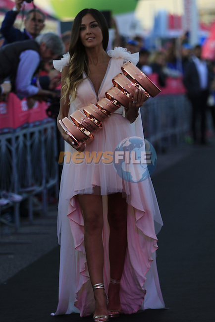 The Madrina Giorgia Palmas with the Trophie Senza Fine on stage at theTeam Presentation in Alghero, Sardinia for the 100th edition of the Giro d'Italia 2017, Sardinia, Italy. 4th May 2017.<br /> Picture: Eoin Clarke   Cyclefile<br /> <br /> <br /> All photos usage must carry mandatory copyright credit (&copy; Cyclefile   Eoin Clarke)