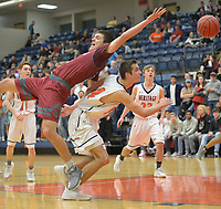 NWA Democrat-Gazette/ANDY SHUPE<br /> Springdale's Carl Fitch (left) loses his footing as he reaches for a pass and collides with Rogers Heritage's Seth Stanley Friday, Jan. 5, 2017, during the second half in War Eagle Arena in Rogers. Visit nwadg.com/photos to see more photographs from the games.