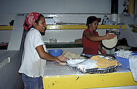 Women making tortillas in the Guamilito Market, San Pedro Sula, Honduras