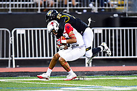 Baltimore, MD - OCT 14, 2017: Towson Tigers linebacker Diondre Wallace (56) tackles Richmond Spiders wide receiver Tyler Wilkins (19) during game between Towson and Richmond at Johnny Unitas Stadium in Baltimore, MD. The Spiders defeated the Tigers 23-3. (Photo by Phil Peters/Media Images International)