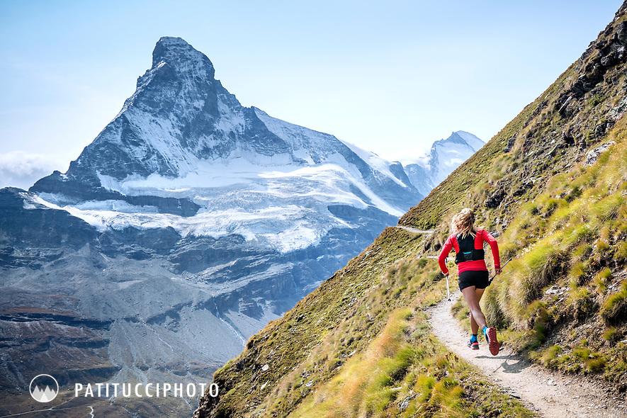 Trail running above Zermatt, Switzerland with the Matterhorn in the distance.