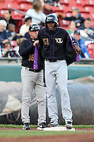May 3, 2010:  Starting pitcher Aroldis Chapman (51) of the Louisville Bats gets help from Manager Rick Sweet to put on a jacket during a game vs. the Buffalo Bisons at Coca-Cola Field in Buffalo, NY.   Louisville defeated Buffalo by the score of 20-7, Chapman got the win on the mound.  Photo By Mike Janes/Four Seam Images