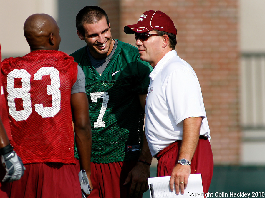TALLAHASSEE, FL 8/5/10 FSU 080510 CH-Florida State Head Coach Jimbo Fisher, right, talks with Bert Reed, left, and Christian Ponder during the first day of practice Thursday in Tallahassee. .COLIN HACKLEY PHOTO