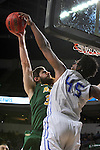 SIOUX FALLS, SD - MARCH 7:  Brent Calhoun #45 of Fort Wayne blocks the shot of Chris Kading #34 of North Dakota State in the 2016 Summit League Tournament.  (Photo by Dick Carlson/Inertia)