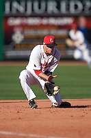 Ball State Cardinals third baseman Sean Kennedy (10) fields a ground ball during a game against the Louisville Cardinals on February 19, 2017 at Spectrum Field in Clearwater, Florida.  Louisville defeated Ball State 10-4.  (Mike Janes/Four Seam Images)
