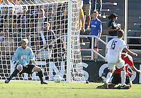 David Meves #24of the University of Akron stops a shot from Dylan Mares #22 of the University of Louisville during the 2010 College Cup final at Harder Stadium, on December 12 2010, in Santa Barbara, California.Akron champions, 1-0.