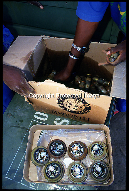 diangol00423. Angola Cunene Province. Detonators taken from mines  by German humanitarian demining NGO, Cap Anamur, near Xangongo, in clearing landmines, and other explosives, left behind during the civil war .11/93.© Rodger Bosch/iAfrika Photos