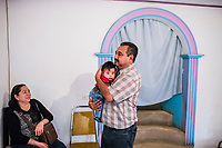 Carlos Saldana, holds his grandson Vicente, 4 months, as his sister María Isabel Saldaña Grajales looks on during a birthday party for their grandson, Hector Yael, 10, at a family gathering at Vicky's daughter, Cinthia Hernández Delgadilo's house in Xalapa, Mexico on November 4, 2017. <br /> Photo Daniel Berehulak for The New York Times
